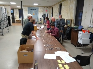 Sean Taylor, Chris Moore Joe Wilkinson, Al Goodyear, and CArl Steen examine the Kolb SIte spear points and arrowheads.