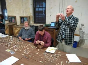 Carl, Joe and Al inspecting Early Archaic (10,000- 8,000 years old) Spearpoints